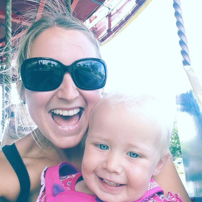 Zara and I on the merry-go-round. Holiday with kids