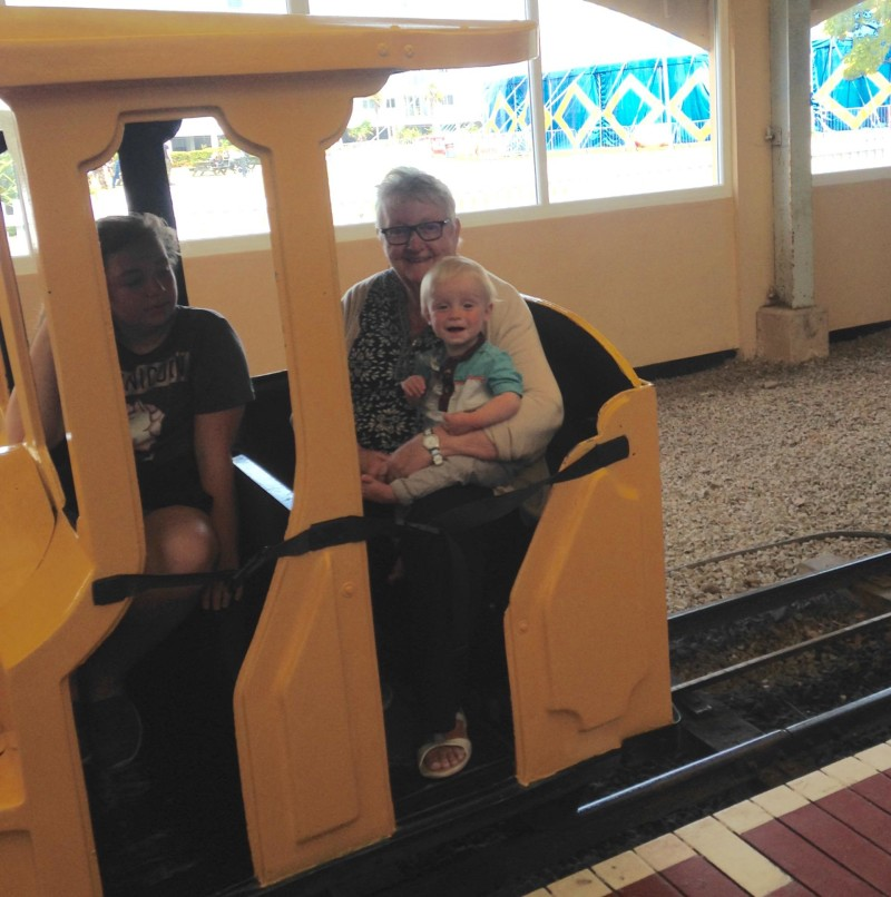 Toby in train ride with nanny pat