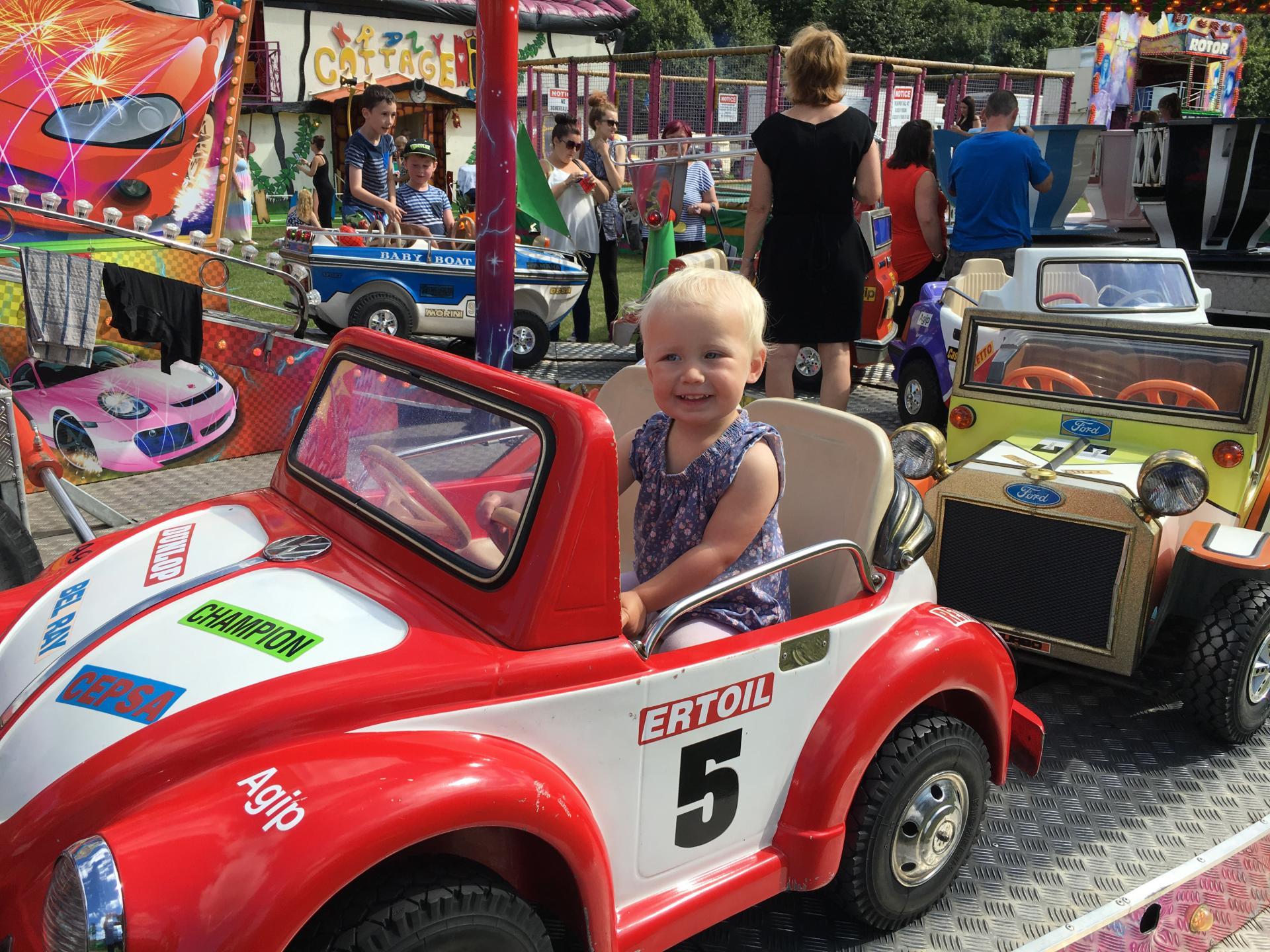 Zara in car ride at the fair