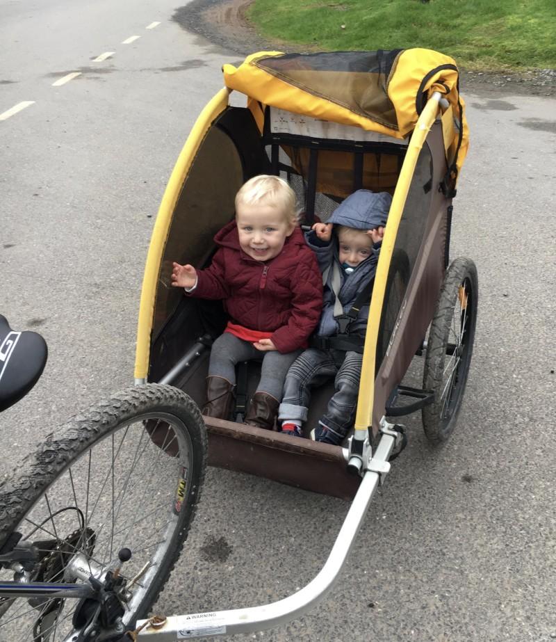 Zara and Toby in back of bike
