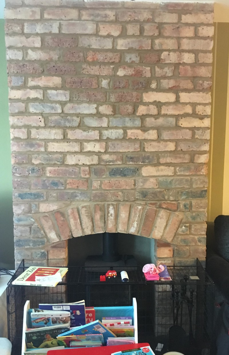 Our exposed brick fire place. The feature for the industrial style room